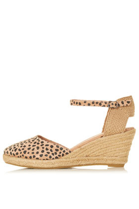 Wade Closed Toe Espadrilles - predominant colour: camel; occasions: casual, work, holiday; material: suede; heel height: mid; embellishment: buckles; ankle detail: ankle strap; heel: wedge; toe: round toe; style: slingbacks; trends: statement prints; finish: plain; pattern: animal print; season: s/s 2013