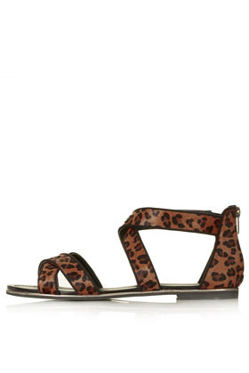 Figaro Cris Cross Sandals - predominant colour: tan; occasions: casual, holiday; material: leather; heel height: flat; ankle detail: ankle strap; heel: standard; toe: open toe/peeptoe; style: strappy; finish: plain; pattern: animal print; season: s/s 2013