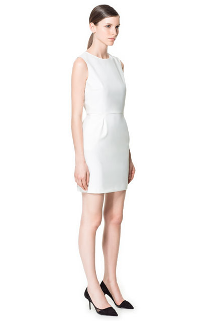 Backless Dress - style: shift; length: mid thigh; neckline: round neck; fit: fitted at waist; pattern: plain; sleeve style: sleeveless; waist detail: fitted waist; back detail: low cut/open back; predominant colour: ivory/cream; occasions: casual, evening, occasion; fibres: polyester/polyamide - stretch; sleeve length: sleeveless; texture group: crepes; pattern type: fabric; pattern size: standard; season: s/s 2013