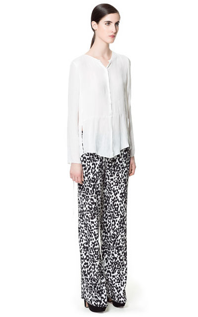 Animal Print Trousers - length: standard; style: palazzo; pocket detail: small back pockets, pockets at the sides; waist: mid/regular rise; predominant colour: white; occasions: casual, evening, work; fibres: polyester/polyamide - 100%; texture group: cotton feel fabrics; trends: statement prints; fit: wide leg; pattern type: fabric; pattern: animal print; season: s/s 2013; pattern size: standard (bottom)