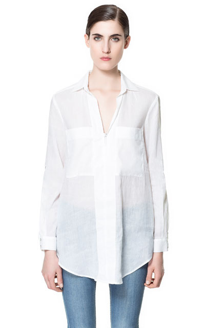 V Neck Blouse - neckline: shirt collar/peter pan/zip with opening; pattern: plain; length: below the bottom; bust detail: pocket detail at bust; style: blouse; predominant colour: white; occasions: casual, evening, work; fibres: cotton - mix; fit: loose; sleeve length: long sleeve; sleeve style: standard; texture group: sheer fabrics/chiffon/organza etc.; pattern type: fabric; season: s/s 2013