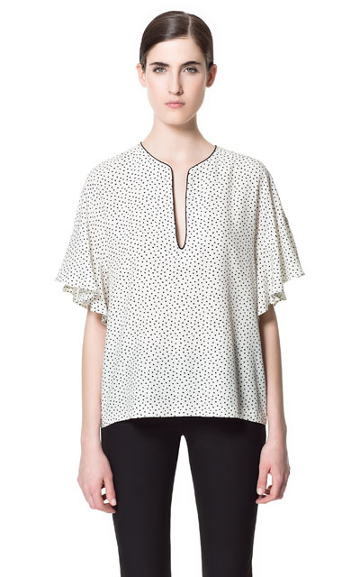 Printed Top With Frill Sleeves - neckline: v-neck; sleeve style: angel/waterfall; predominant colour: ivory/cream; occasions: casual, evening, work; length: standard; style: top; fibres: polyester/polyamide - 100%; fit: loose; sleeve length: short sleeve; texture group: sheer fabrics/chiffon/organza etc.; pattern type: fabric; pattern size: standard; pattern: patterned/print; season: s/s 2013