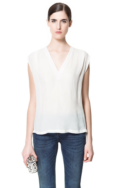 Loose Blouse - neckline: v-neck; pattern: plain; sleeve style: sleeveless; style: blouse; predominant colour: white; occasions: casual, evening, work; length: standard; fibres: polyester/polyamide - 100%; fit: straight cut; back detail: longer hem at back than at front; sleeve length: sleeveless; texture group: sheer fabrics/chiffon/organza etc.; pattern type: fabric; season: s/s 2013