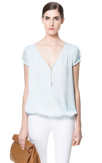 Blouse With Zip Neckline - neckline: low v-neck; sleeve style: capped; pattern: plain; style: blouse; predominant colour: pale blue; occasions: casual, evening, work; length: standard; fibres: polyester/polyamide - 100%; fit: loose; sleeve length: short sleeve; texture group: sheer fabrics/chiffon/organza etc.; pattern type: fabric; season: s/s 2013