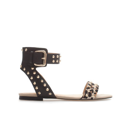Studded Leopard Print Vamp - predominant colour: black; occasions: casual; material: leather; heel height: flat; embellishment: studs; ankle detail: ankle strap; heel: standard; toe: open toe/peeptoe; style: standard; finish: plain; pattern: animal print; season: s/s 2013
