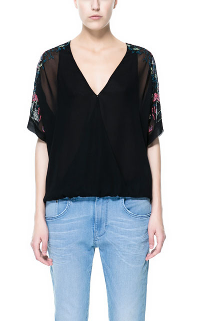 Japanese Wrap Top With Embroidered Sleeve - neckline: low v-neck; sleeve style: dolman/batwing; style: wrap/faux wrap; shoulder detail: contrast pattern/fabric at shoulder; predominant colour: black; occasions: casual, evening; length: standard; fibres: polyester/polyamide - 100%; fit: straight cut; sleeve length: half sleeve; pattern type: fabric; pattern size: light/subtle; texture group: other - light to midweight; embellishment: embroidered; season: s/s 2013