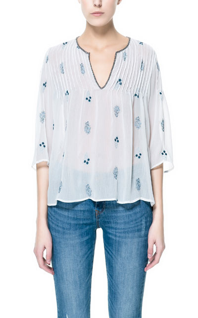 Printed Embroidered Top - neckline: v-neck; pattern: plain; style: blouse; bust detail: subtle bust detail; predominant colour: white; occasions: casual, holiday; length: standard; fibres: polyester/polyamide - 100%; fit: loose; shoulder detail: subtle shoulder detail; sleeve length: 3/4 length; sleeve style: standard; texture group: sheer fabrics/chiffon/organza etc.; pattern type: fabric; embellishment: embroidered; season: s/s 2013; wardrobe: highlight