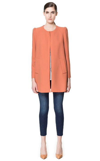 Coat With Gathering On The Shoulder - pattern: plain; collar: round collar/collarless; style: single breasted; length: mid thigh; predominant colour: coral; occasions: casual, work, occasion; fit: straight cut (boxy); fibres: polyester/polyamide - mix; shoulder detail: bulky shoulder detail; sleeve length: long sleeve; sleeve style: standard; texture group: crepes; collar break: high; pattern type: fabric; season: s/s 2013