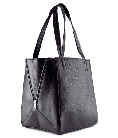 Bag - predominant colour: black; occasions: casual, work; style: tote; length: shoulder (tucks under arm); size: standard; material: faux leather; embellishment: zips; pattern: plain; finish: plain; season: s/s 2013