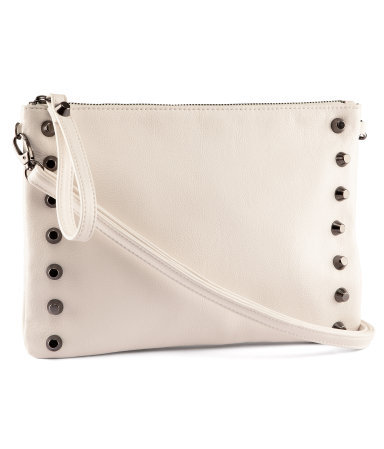 Clutch - predominant colour: ivory/cream; occasions: casual, evening, occasion, holiday; type of pattern: standard; style: clutch; length: hand carry; size: standard; material: faux leather; embellishment: studs; pattern: plain; finish: plain; season: s/s 2013