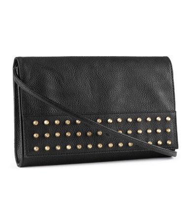Clutch - predominant colour: black; occasions: evening, work, occasion; type of pattern: standard; style: clutch; length: hand carry; size: standard; material: faux leather; embellishment: studs; pattern: plain; finish: plain; season: s/s 2013