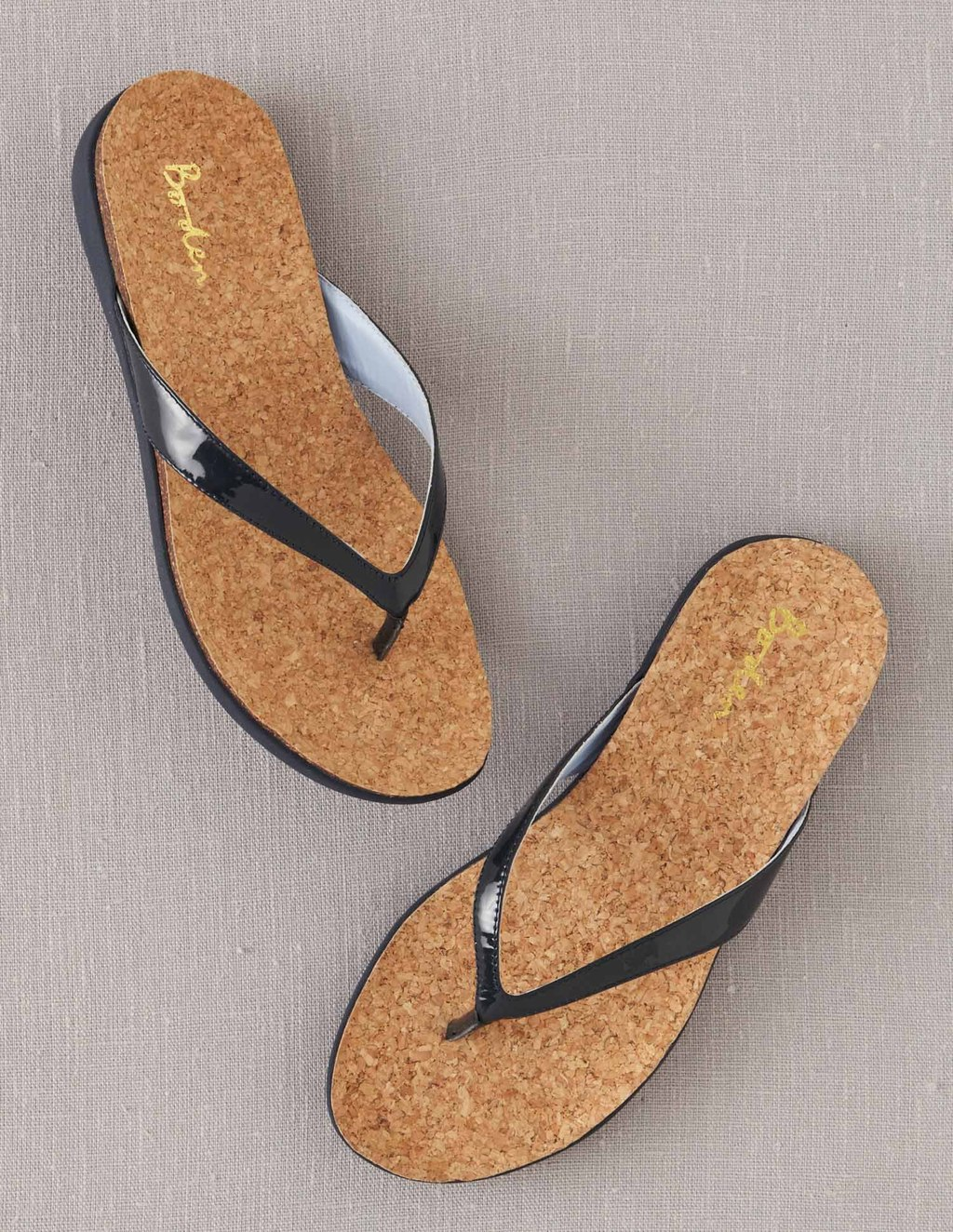 Casual Flip Flops - predominant colour: navy; occasions: casual, holiday; material: leather; heel height: flat; heel: standard; toe: open toe/peeptoe; style: flip flops; finish: patent; pattern: plain; season: s/s 2013