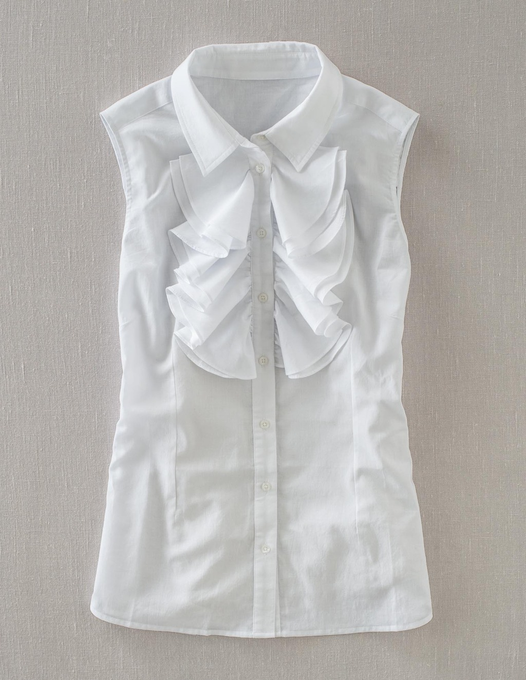 Sleeveless Ruffle Shirt - neckline: shirt collar/peter pan/zip with opening; pattern: plain; sleeve style: sleeveless; style: shirt; predominant colour: white; occasions: casual, evening, work; length: standard; fibres: cotton - 100%; fit: tailored/fitted; sleeve length: sleeveless; texture group: cotton feel fabrics; trends: sculptural frills; bust detail: tiers/frills/bulky drapes/pleats; pattern type: fabric; season: s/s 2013