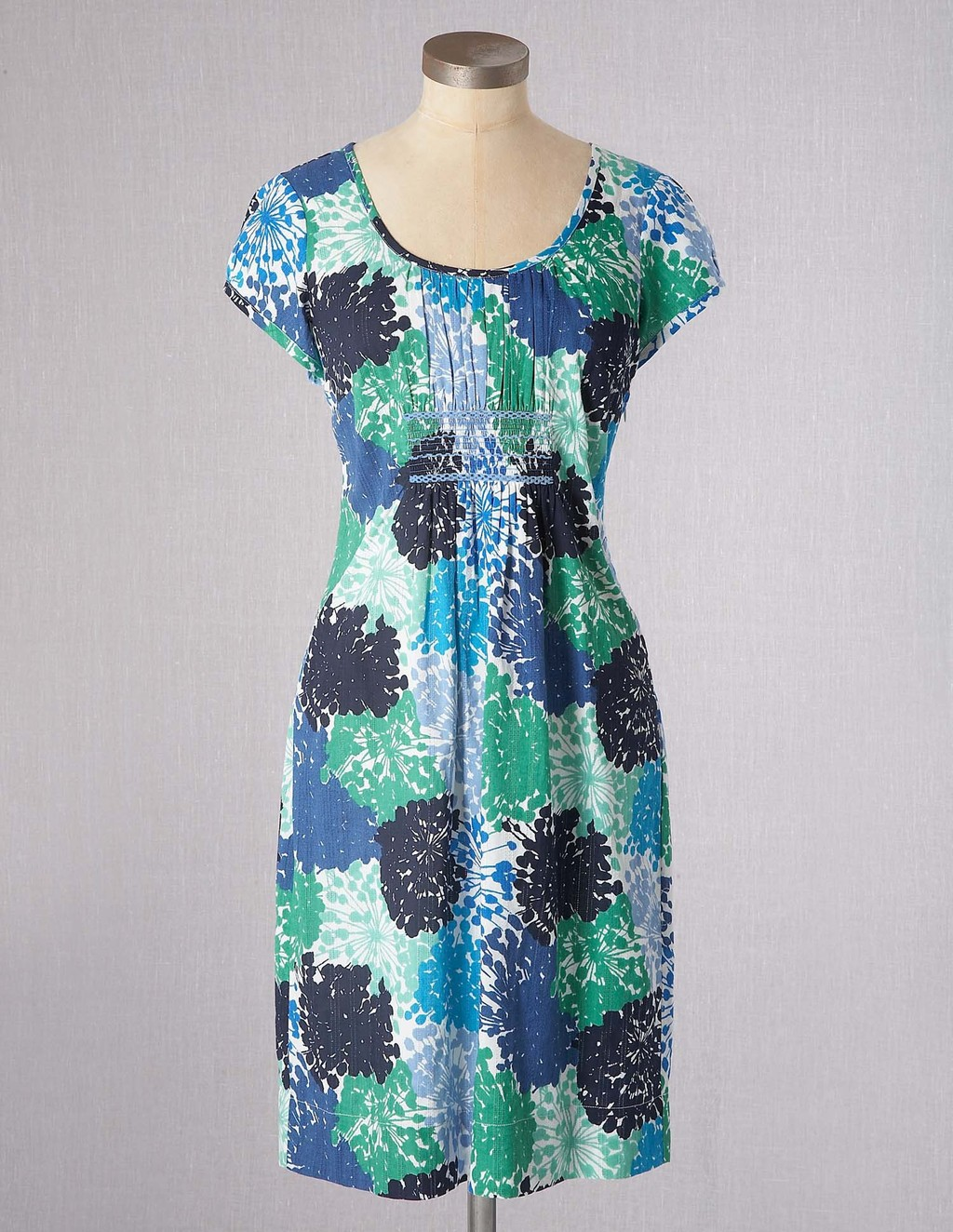 Breezy Beach Dress - neckline: round neck; sleeve style: capped; fit: empire; style: sundress; bust detail: subtle bust detail; predominant colour: royal blue; occasions: casual, holiday; length: just above the knee; fibres: cotton - 100%; hip detail: subtle/flattering hip detail; sleeve length: short sleeve; pattern type: fabric; pattern size: big & busy; pattern: florals; texture group: jersey - stretchy/drapey; season: s/s 2013