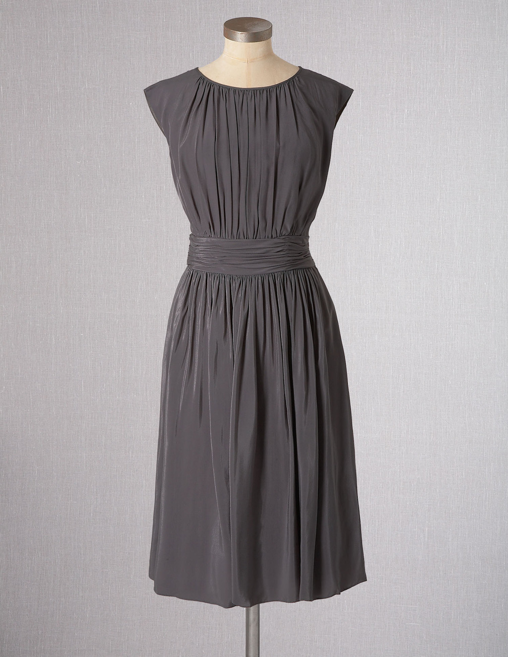 Selina Dress - neckline: round neck; sleeve style: capped; fit: fitted at waist; pattern: plain; style: blouson; waist detail: fitted waist; bust detail: ruching/gathering/draping/layers/pintuck pleats at bust; predominant colour: charcoal; occasions: casual; length: on the knee; fibres: viscose/rayon - 100%; hip detail: soft pleats at hip/draping at hip/flared at hip; sleeve length: sleeveless; pattern type: fabric; texture group: other - light to midweight; season: s/s 2013