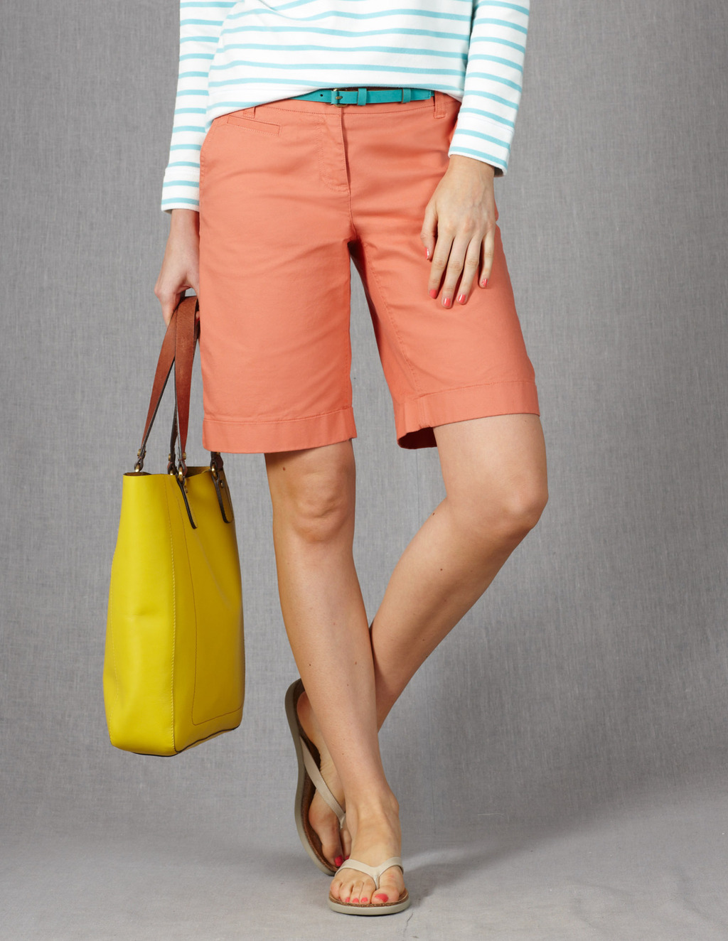 Off Duty Shorts - pattern: plain; pocket detail: small back pockets, pockets at the sides; waist detail: belted waist/tie at waist/drawstring; waist: mid/regular rise; predominant colour: coral; occasions: casual, holiday; fibres: cotton - stretch; texture group: cotton feel fabrics; pattern type: fabric; season: s/s 2013; pattern size: standard (bottom); style: shorts; length: mid thigh shorts; fit: standard