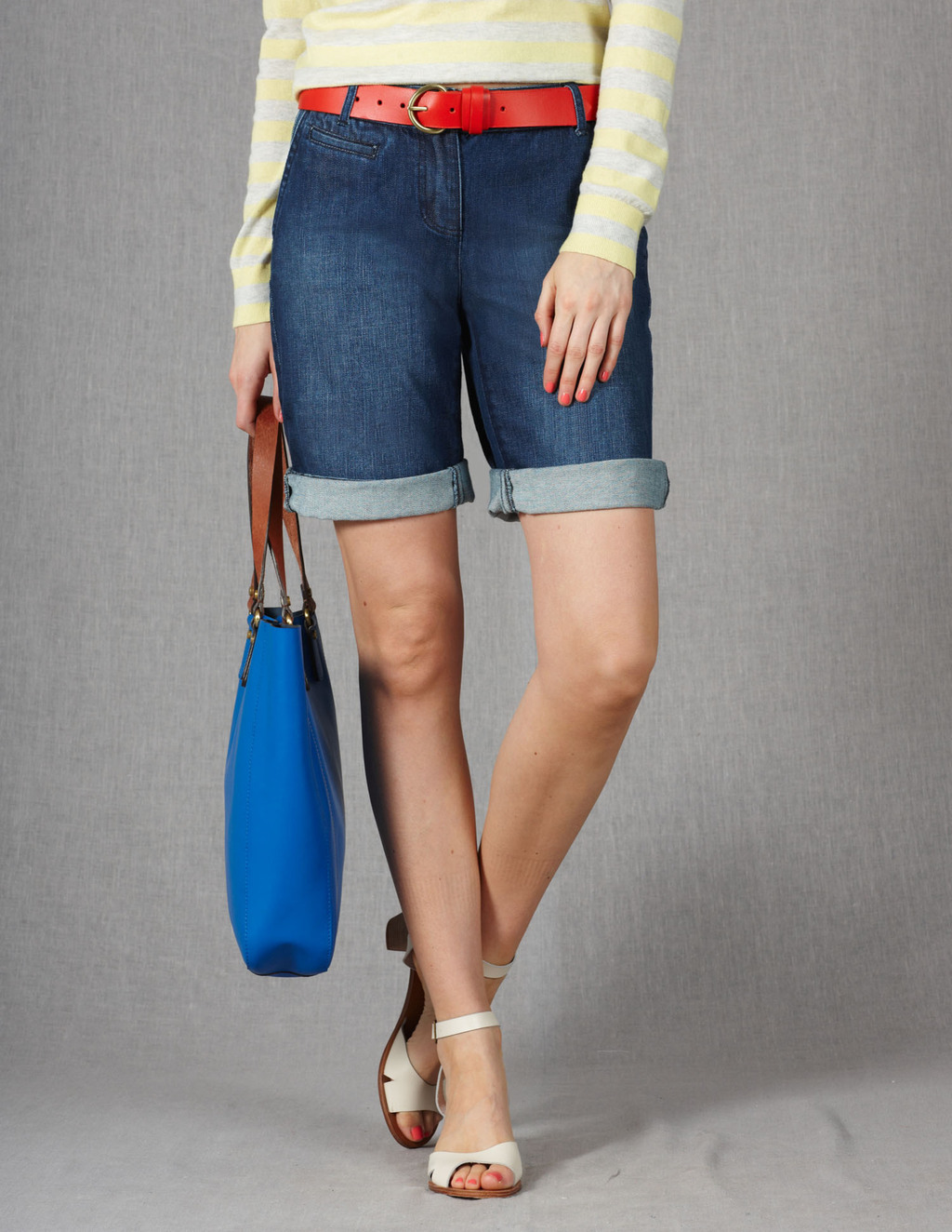 Off Duty Shorts - pattern: plain; waist detail: belted waist/tie at waist/drawstring; pocket detail: traditional 5 pocket; waist: mid/regular rise; predominant colour: denim; occasions: casual, holiday; fibres: cotton - stretch; texture group: denim; pattern type: fabric; season: s/s 2013; pattern size: standard (bottom); style: denim; length: mid thigh shorts; fit: slim leg