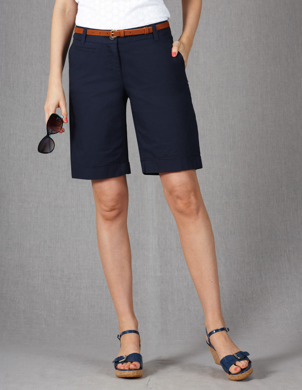 Off Duty Shorts - pattern: plain; waist detail: belted waist/tie at waist/drawstring; pocket detail: traditional 5 pocket; waist: mid/regular rise; predominant colour: navy; occasions: casual, holiday; fibres: cotton - stretch; texture group: cotton feel fabrics; pattern type: fabric; season: s/s 2013; pattern size: standard (bottom); style: tailored shorts; length: just above the knee; fit: slim leg