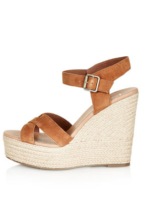 Whispered Cross Over Wedges - predominant colour: tan; occasions: casual, holiday; material: suede; heel height: high; embellishment: buckles; ankle detail: ankle strap; heel: wedge; toe: open toe/peeptoe; style: standard; finish: plain; pattern: plain; season: s/s 2013