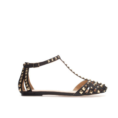 Studded Sandal - predominant colour: black; occasions: casual, creative work; material: leather; heel height: flat; embellishment: studs; ankle detail: ankle strap; heel: standard; toe: open toe/peeptoe; style: strappy; finish: plain; pattern: plain; season: s/s 2013