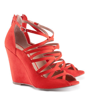 Sandals - predominant colour: true red; occasions: casual, creative work; material: fabric; heel height: high; ankle detail: ankle strap; heel: wedge; toe: open toe/peeptoe; style: strappy; finish: plain; pattern: plain; season: s/s 2013