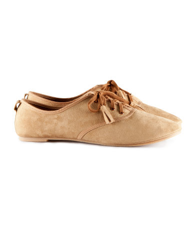 Shoes - predominant colour: camel; occasions: casual, work; material: fabric; heel height: flat; embellishment: tassels; toe: round toe; finish: plain; pattern: plain; style: lace ups; season: s/s 2013