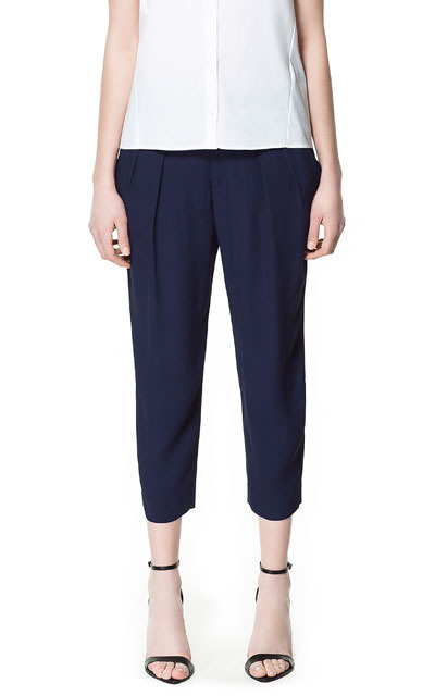 Pleated Ankle Length Trousers - pattern: plain; style: peg leg; waist: mid/regular rise; predominant colour: navy; occasions: evening, work; length: calf length; fibres: polyester/polyamide - 100%; hip detail: front pleats at hip level; texture group: crepes; fit: tapered; pattern type: fabric; season: s/s 2013; pattern size: standard (bottom)