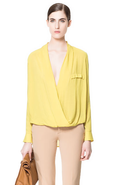 Draped Viscose Blouse - neckline: low v-neck; pattern: plain; style: blouse; bust detail: subtle bust detail; predominant colour: primrose yellow; occasions: casual, evening, work; length: standard; fibres: polyester/polyamide - 100%; fit: loose; sleeve length: long sleeve; sleeve style: standard; texture group: sheer fabrics/chiffon/organza etc.; pattern type: fabric; season: s/s 2013; wardrobe: highlight