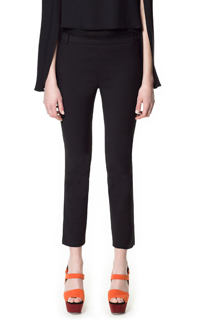 Trousers With Side Split - pattern: plain; pocket detail: small back pockets, pockets at the sides; waist: mid/regular rise; predominant colour: black; occasions: casual, evening, work; length: ankle length; fibres: cotton - mix; texture group: crepes; fit: straight leg; pattern type: fabric; style: standard; season: s/s 2013; pattern size: standard (bottom)