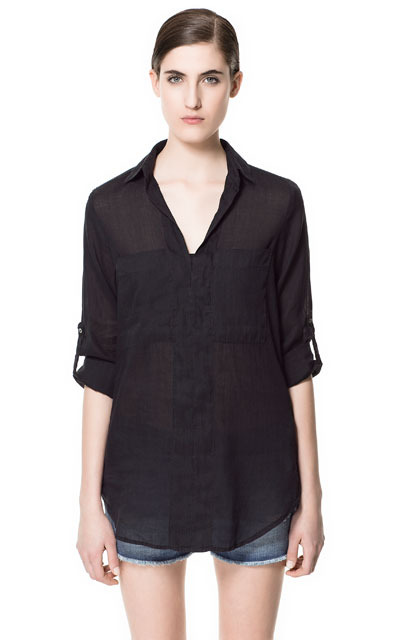 V Neck Blouse - neckline: v-neck; pattern: plain; length: below the bottom; bust detail: pocket detail at bust; style: blouse; predominant colour: black; occasions: casual, holiday; fibres: cotton - mix; fit: loose; sleeve length: 3/4 length; sleeve style: standard; texture group: sheer fabrics/chiffon/organza etc.; pattern type: fabric; pattern size: standard; season: s/s 2013