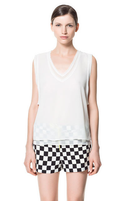 Mock Layered V Neck Top - neckline: v-neck; pattern: plain; sleeve style: sleeveless; predominant colour: ivory/cream; occasions: casual, evening, work, holiday; length: standard; style: top; fibres: polyester/polyamide - 100%; fit: loose; sleeve length: sleeveless; texture group: sheer fabrics/chiffon/organza etc.; pattern type: fabric; pattern size: standard; season: s/s 2013