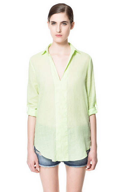 V Neck Blouse - neckline: shirt collar/peter pan/zip with opening; pattern: plain; length: below the bottom; style: blouse; predominant colour: lime; occasions: casual, holiday; fibres: cotton - mix; fit: loose; sleeve length: 3/4 length; sleeve style: standard; texture group: sheer fabrics/chiffon/organza etc.; pattern type: fabric; pattern size: standard; season: s/s 2013
