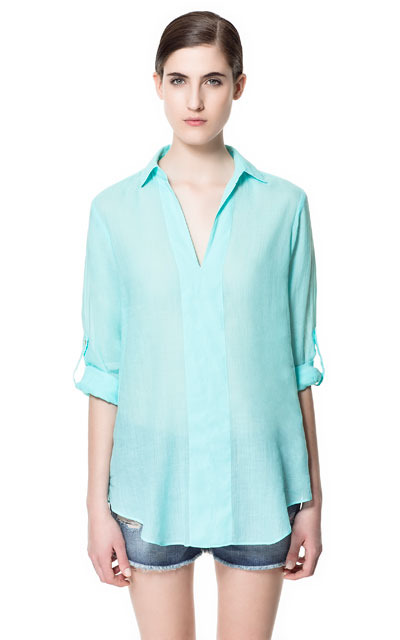 V Neck Blouse - neckline: shirt collar/peter pan/zip with opening; pattern: plain; length: below the bottom; style: blouse; predominant colour: turquoise; occasions: casual, holiday; fibres: cotton - mix; fit: loose; sleeve length: 3/4 length; sleeve style: standard; texture group: sheer fabrics/chiffon/organza etc.; pattern type: fabric; pattern size: standard; season: s/s 2013