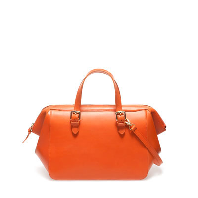 Leather Bowling Bag - predominant colour: bright orange; occasions: casual, work; type of pattern: standard; style: bowling; length: handle; size: standard; material: leather; pattern: plain; finish: plain; embellishment: buckles; season: s/s 2013
