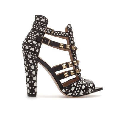 Studded Sandals - predominant colour: black; occasions: evening, occasion, holiday; material: leather; heel height: high; embellishment: buckles, studs; ankle detail: ankle strap; heel: block; toe: open toe/peeptoe; style: strappy; finish: plain; pattern: patterned/print; season: s/s 2013