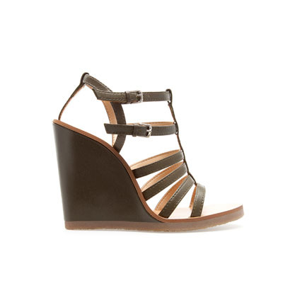 Strappy Wedge Sandal - predominant colour: chocolate brown; occasions: casual, creative work; material: leather; heel height: high; embellishment: buckles; ankle detail: ankle strap; heel: wedge; toe: open toe/peeptoe; style: strappy; finish: plain; pattern: plain; season: s/s 2013