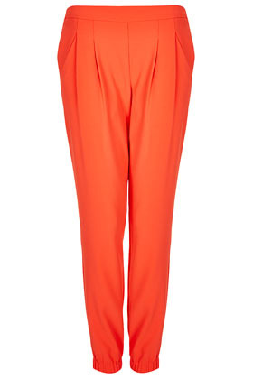 Crepe Cuffed Joggers - length: standard; pattern: plain; waist detail: fitted waist, narrow waistband; pocket detail: small back pockets, pockets at the sides; waist: mid/regular rise; predominant colour: bright orange; occasions: casual, evening, work, holiday; fibres: polyester/polyamide - 100%; hip detail: front pleats at hip level; texture group: crepes; trends: sporty redux, fluorescent; fit: slim leg; pattern type: fabric; style: standard; season: s/s 2013