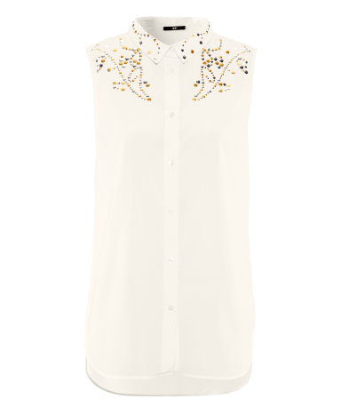 Blouse - neckline: shirt collar/peter pan/zip with opening; pattern: plain; sleeve style: sleeveless; bust detail: added detail/embellishment at bust; length: below the bottom; style: blouse; predominant colour: ivory/cream; occasions: casual, evening, work, holiday; fibres: polyester/polyamide - 100%; fit: straight cut; shoulder detail: added shoulder detail; sleeve length: sleeveless; texture group: sheer fabrics/chiffon/organza etc.; pattern type: fabric; embellishment: beading; season: s/s 2013