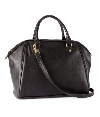 Bag - predominant colour: black; occasions: casual, work; style: tote; length: handle; size: standard; material: faux leather; embellishment: studs; pattern: plain; finish: plain; season: s/s 2013