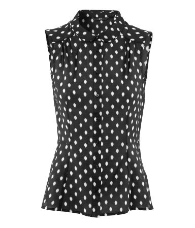 Blouse - neckline: shirt collar/peter pan/zip with opening; sleeve style: sleeveless; waist detail: fitted waist; style: shirt; pattern: polka dot, patterned/print; bust detail: buttons at bust (in middle at breastbone)/zip detail at bust; predominant colour: black; occasions: casual, work; length: standard; fibres: cotton - mix; fit: body skimming; shoulder detail: flat/draping pleats/ruching/gathering at shoulder; sleeve length: sleeveless; texture group: cotton feel fabrics; pattern type: fabric; pattern size: standard; season: s/s 2013