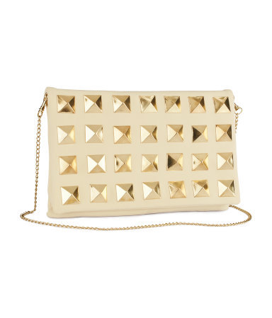 Clutch - predominant colour: ivory/cream; occasions: evening, occasion; type of pattern: standard; style: clutch; length: hand carry; size: standard; material: faux leather; embellishment: studs, chain/metal; pattern: plain; finish: plain; season: s/s 2013