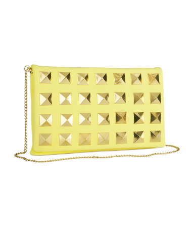 Clutch - predominant colour: primrose yellow; occasions: evening, occasion; style: clutch; length: hand carry; size: standard; material: faux leather; embellishment: studs, chain/metal; pattern: plain; trends: metallics; finish: plain; season: s/s 2013