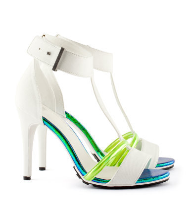 Sandals - predominant colour: white; occasions: casual, evening, holiday; material: fabric; heel height: high; embellishment: buckles; ankle detail: ankle strap; heel: stiletto; toe: open toe/peeptoe; style: strappy; trends: sporty redux; finish: plain; pattern: plain, colourblock; season: s/s 2013