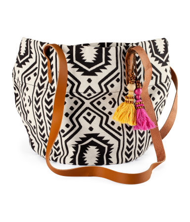 Bag - occasions: casual, holiday; predominant colour: multicoloured; type of pattern: standard; style: saddle; length: across body/long; size: standard; material: fabric; embellishment: tassels; trends: statement prints; finish: plain; pattern: patterned/print; season: s/s 2013; multicoloured: multicoloured