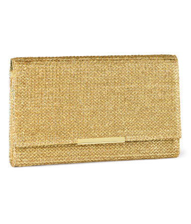 Clutch - predominant colour: gold; occasions: evening, occasion; type of pattern: standard; style: clutch; length: hand carry; size: small; material: macrame/raffia/straw; pattern: plain; trends: metallics; finish: metallic; season: s/s 2013