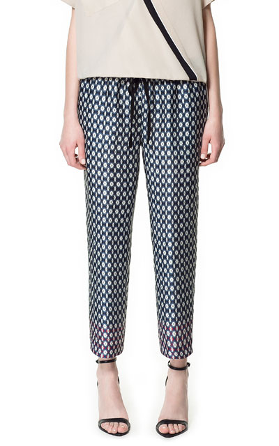 Contrasting Print Trousers - waist detail: belted waist/tie at waist/drawstring; waist: mid/regular rise; predominant colour: navy; occasions: casual, evening, work, holiday; length: ankle length; fibres: polyester/polyamide - 100%; trends: statement prints; fit: slim leg; pattern type: fabric; pattern: patterned/print; texture group: other - light to midweight; style: standard; season: s/s 2013; pattern size: standard (bottom)
