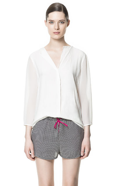Transparent Combination Blouse - neckline: v-neck; pattern: plain; style: blouse; predominant colour: ivory/cream; occasions: casual, evening, work; length: standard; fibres: polyester/polyamide - 100%; fit: loose; back detail: longer hem at back than at front; sleeve length: 3/4 length; sleeve style: standard; texture group: sheer fabrics/chiffon/organza etc.; trends: volume; pattern type: fabric; pattern size: standard; season: s/s 2013