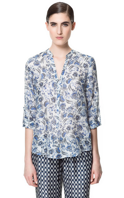 Printed Polo Shirt - style: blouse; bust detail: buttons at bust (in middle at breastbone)/zip detail at bust; occasions: casual, evening, work; length: standard; neckline: collarstand & mandarin with v-neck; fibres: cotton - mix; fit: loose; shoulder detail: discreet epaulette; back detail: longer hem at back than at front; predominant colour: multicoloured; sleeve length: 3/4 length; sleeve style: standard; texture group: sheer fabrics/chiffon/organza etc.; pattern type: fabric; pattern size: standard; pattern: florals; season: s/s 2013; multicoloured: multicoloured