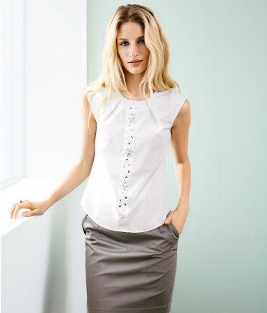 Blouse - neckline: round neck; sleeve style: capped; pattern: plain; style: blouse; predominant colour: white; occasions: casual, evening, work; length: standard; fibres: cotton - 100%; fit: loose; sleeve length: sleeveless; texture group: cotton feel fabrics; pattern type: fabric; embellishment: jewels/stone; season: s/s 2013; wardrobe: highlight