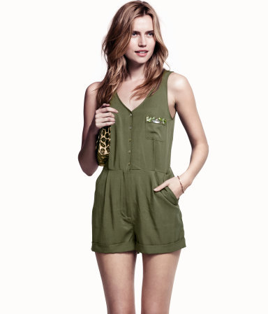 Jumpsuit - neckline: low v-neck; pattern: plain; sleeve style: sleeveless; waist detail: fitted waist; bust detail: buttons at bust (in middle at breastbone)/zip detail at bust; length: mid thigh shorts; predominant colour: khaki; occasions: casual, evening, holiday; fit: body skimming; fibres: viscose/rayon - 100%; jeans & bottoms detail: turn ups; sleeve length: sleeveless; texture group: crepes; style: jumpsuit; pattern type: fabric; pattern size: light/subtle; embellishment: jewels/stone; season: s/s 2013